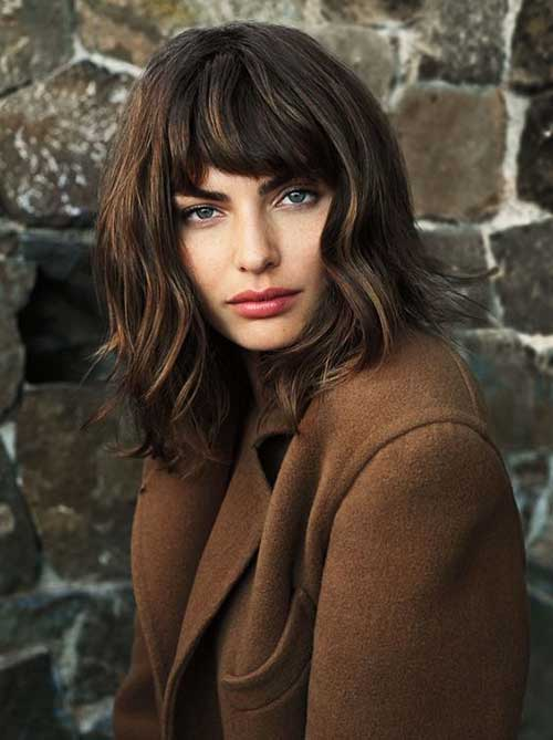 Thick Wavy Long Bob with Bangs Styles